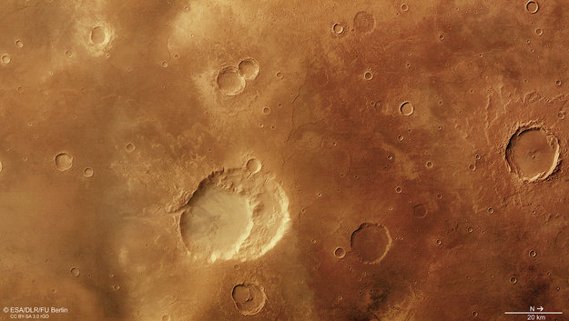 The 30 x 40 km Siloe Patera structure lies close to the centre of this colour image within the Arabia Terra region of Mars. A recent study favours this construct as the remains of a volcanic caldera.