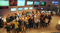 The combined mission control, project and industry teams celebrate the end of LEOP for Sentinel-2A in the Main Control Room at ESOC