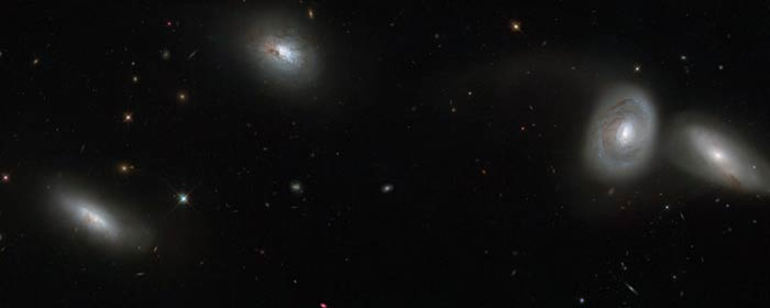 Hubble views a bizarre cosmic quartet