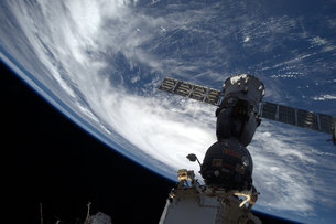 astronauts in an orbiting space shuttle experience a sensation of weightlessness because - photo #41