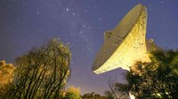This image shows the 35-m diameter dish antenna of ESA's deep space tracking station at New Norcia, Australia, illuminated by station ground lights against the night sky on 3 August 2015.