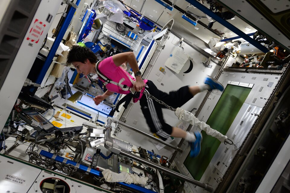 ESA astronaut Samantha Cristoforetti exercising on the International Space Station during her Futura mission in 2015.