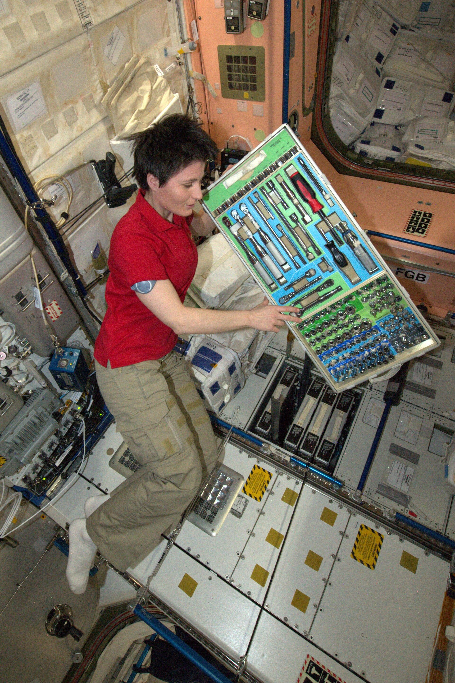 Samantha working in Columbus space laboratory