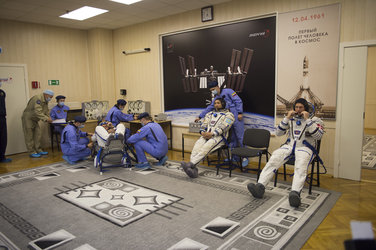 Soyuz TMA-18M crew members dressed in their Russian Sokol suit