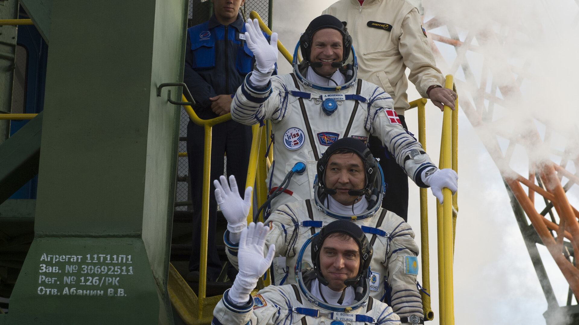 Soyuz TMA-18M crew members greeting audience at the launch pad