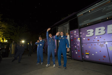 Soyuz TMA-18M crew members wave farewell to family and friends