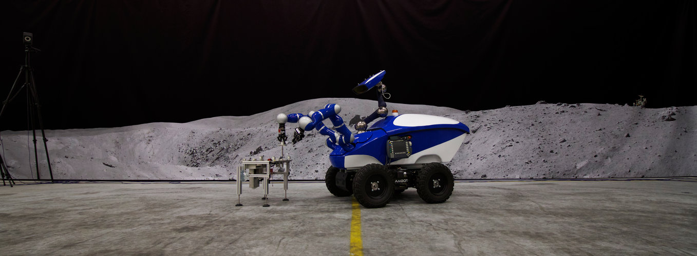 The Interact Centaur Rover in front of a Moon panorama