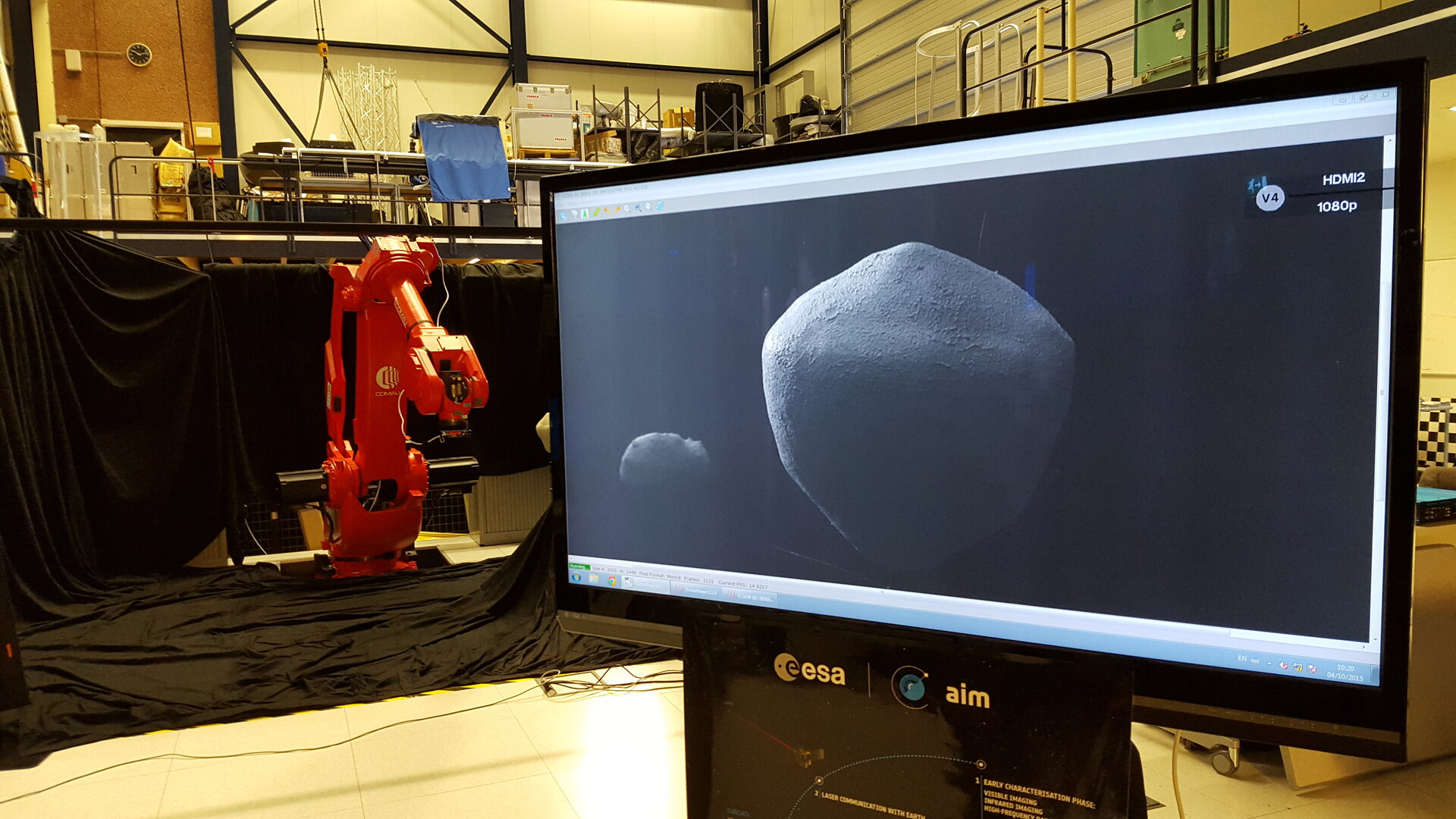 Robotic arm testing AIM mission's camera