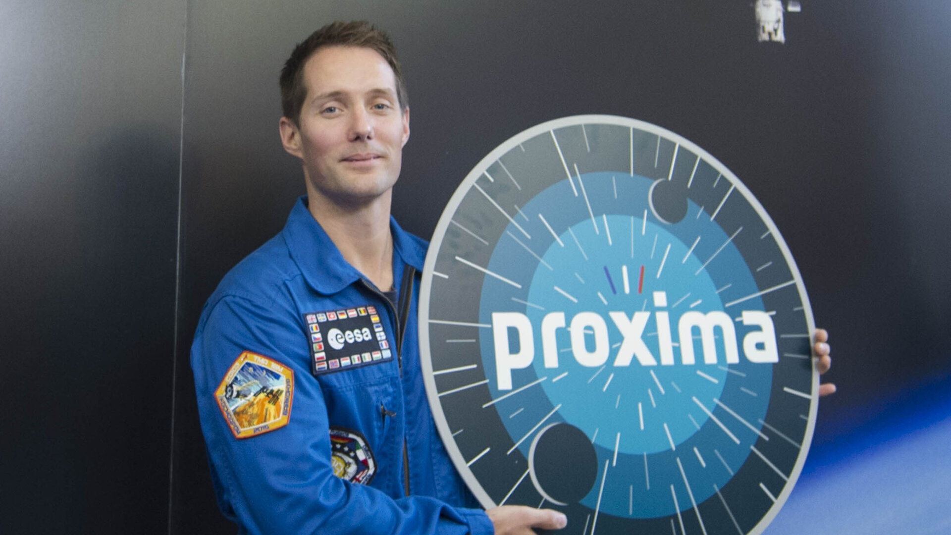 Thomas with Proxima logo
