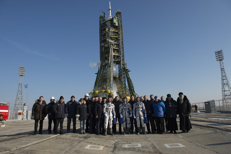 Soyuz TMA-19M crew members and dignitaries at the launch pad