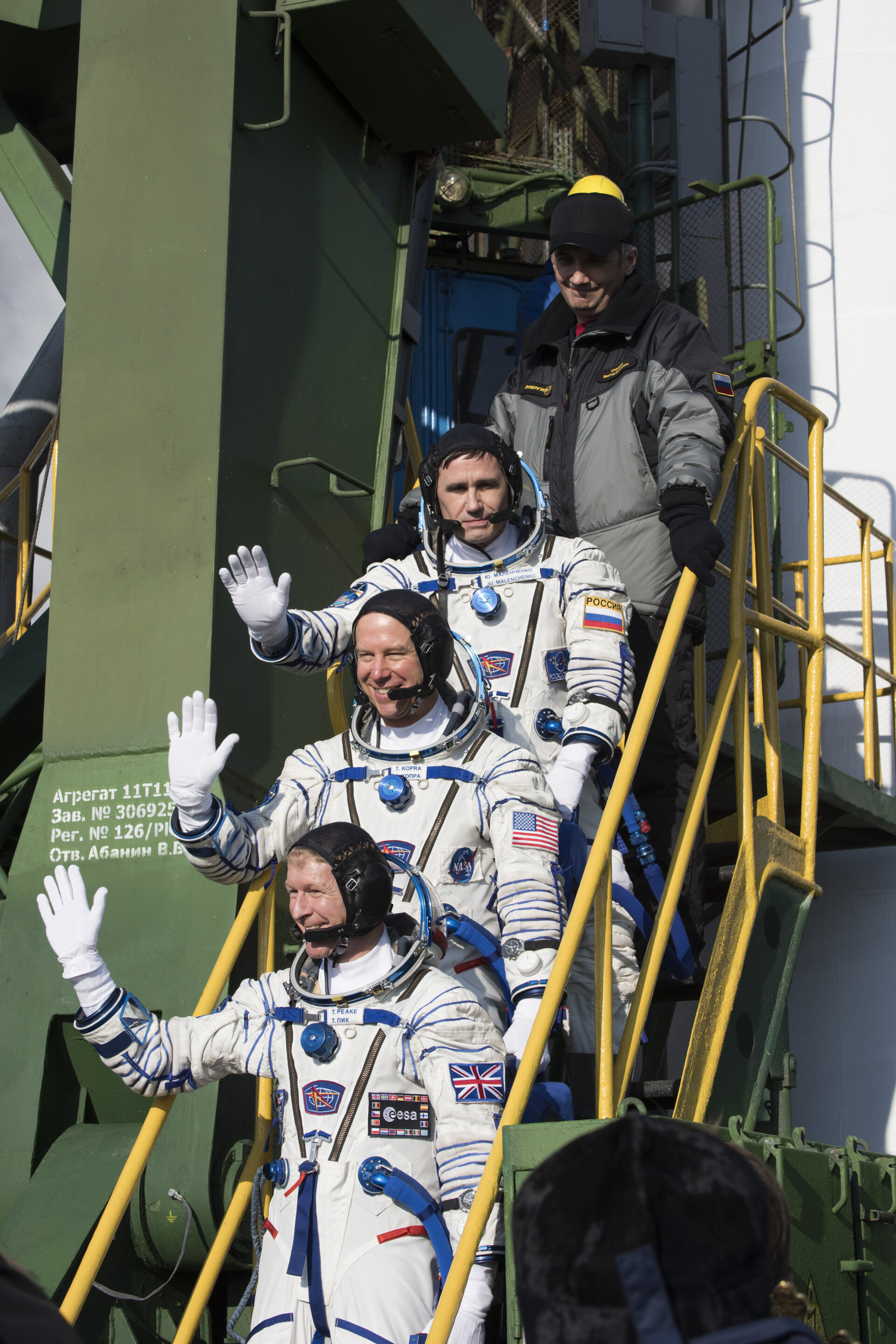 Soyuz TMA-19M crew members greeting audience at the launch pad