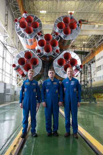 Soyuz TMA-19M crew with launcher