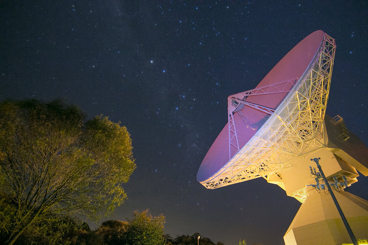 ESA's dish antenna at New Norcia, Australia, glows with reflected laser light