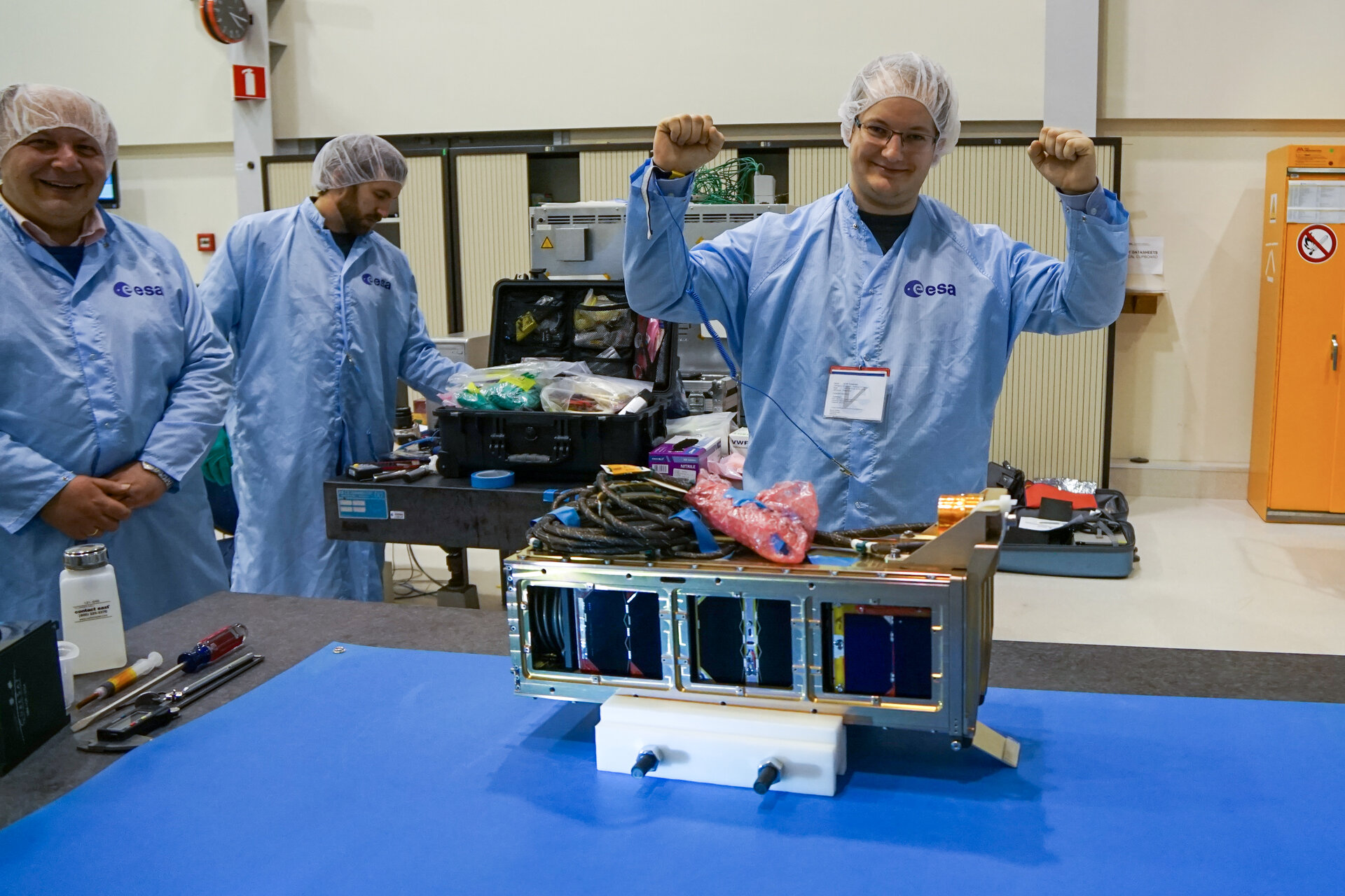 The three CubeSats nicely fitting into their orbital deployer