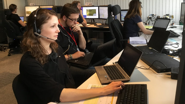 The rover experiment control team located at ESA's ESOC mission control centre, Darmstadt, Germany, watch closely as Tim commands Bridget.