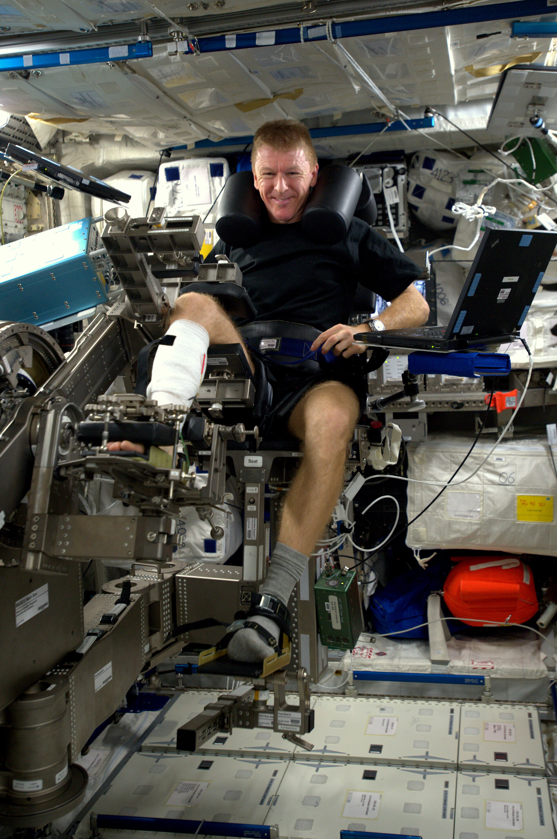 Tim Peake in muscle measurement machine