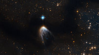 A golden veil cloaks a newborn star