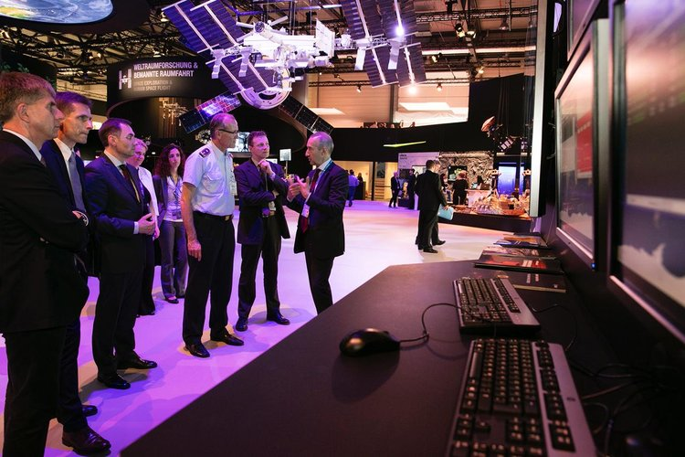 High-level visitors briefed on spacecraft operations at ILA, the Berlin airshow
