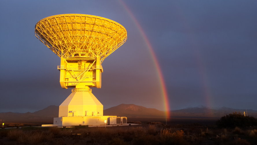 ESA's Malargüe tracking station framed by a rainbow and highlighted by the Sun