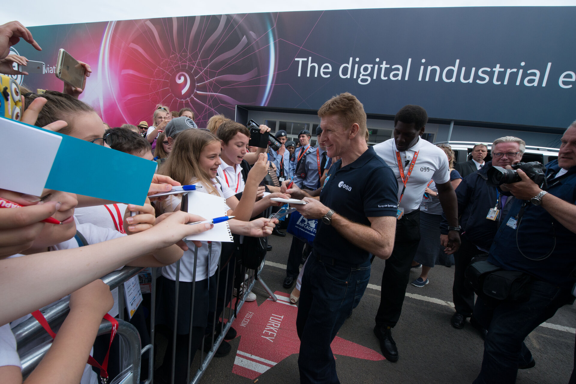 ESA astronaut Tim Peake signing autographs, at Farnborough Airshow 2016