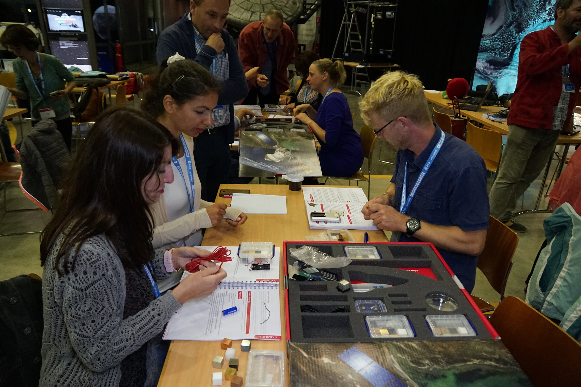 Primary school teachers testing the spacecraft materials kit