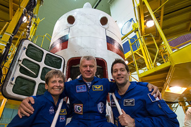 Peggy, Oleg and Thomas in front of Soyuz