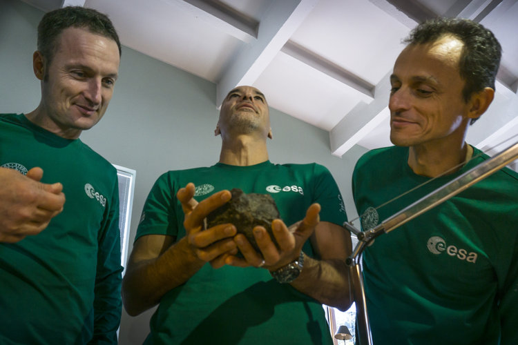 Matthias, Luca and Pedro inspect a meteorite