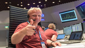 On 19 October 2016, Spacecraft Operations Manager Peter Schmitz gives the thumbs up in the main control room at ESA's ESOC mission control centre shortly after the ExoMars Trace Gas orbiter (TGO) arrived at the Red Planet