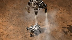 Aterrizaje del robot Curiosity, por debajo de la etapa de descenso que funcionó como grúa. Créditos: NASA/JPL-Caltech