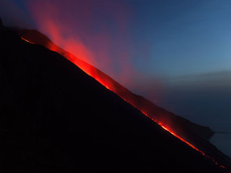 A stream of lava flowing down the slopes of Italy's Stromboli volcano