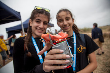 Students holding their CanSat at the 2016 CanSat launch campaign