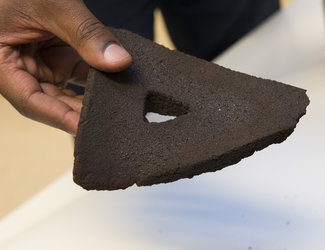 Brick 3D printed from moondust using focused sunlight