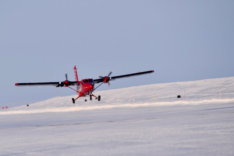 Twin Otter heads off over Arctic Ocean