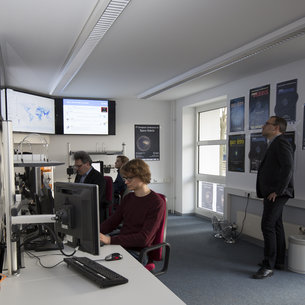 Analysts at work in the space debris facility located at ESA's ESOC mission control centre, Darmstadt, Germany.