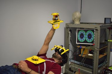 Volunteer astronaut-in-bed takes part in brain test