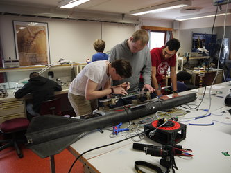 Students preparing the payload of the student rocket