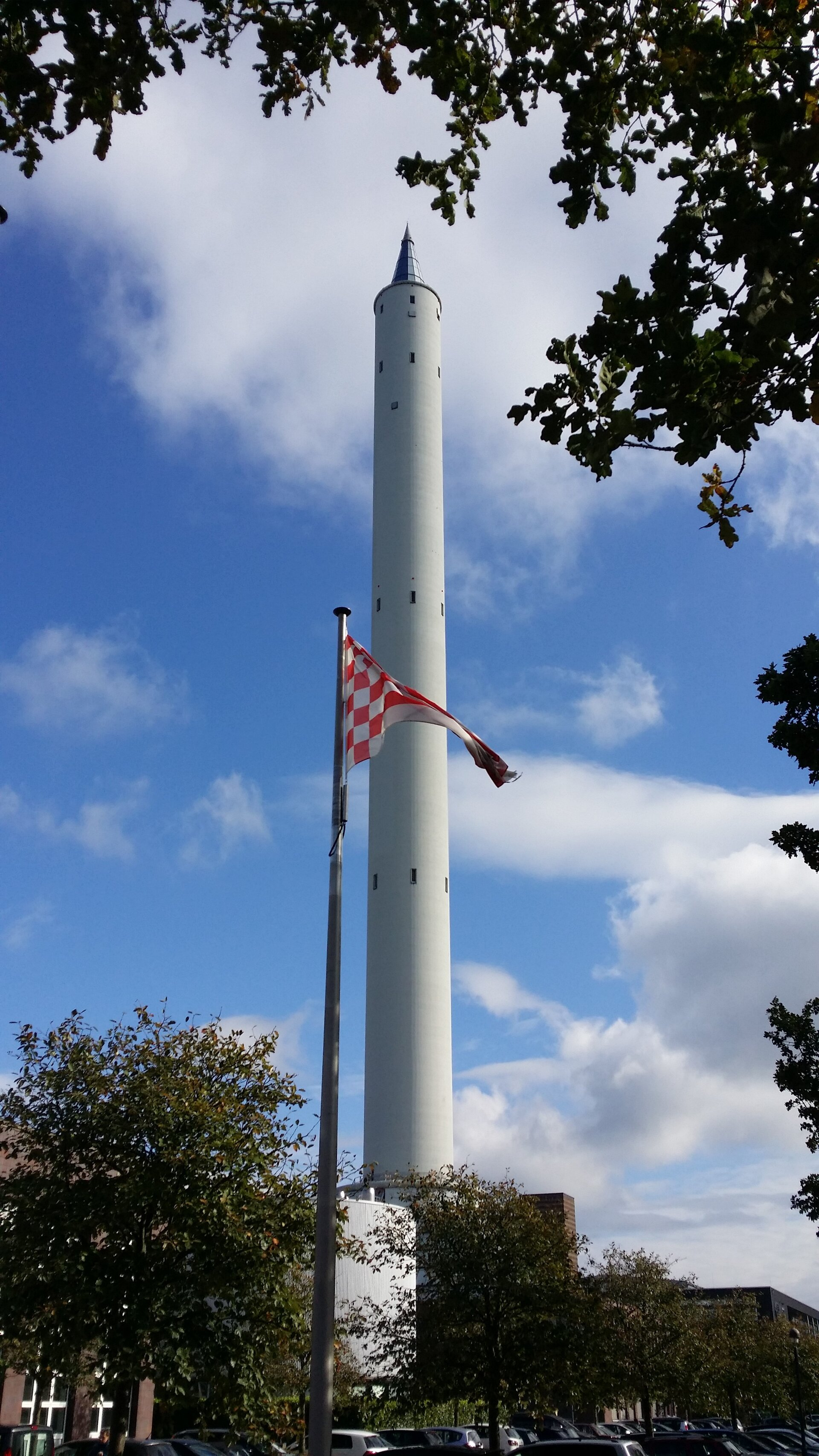 The ZARM Drop Tower behind the flag of Bremen