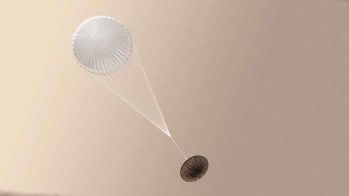 Artist impression of the Schiaparelli module with parachute deployed. Copyright ESA/ATG medialab