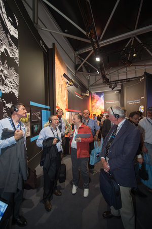 Isabelle Duvaux-Béchon shows AA-IHEDN representives the ESA Pavilion