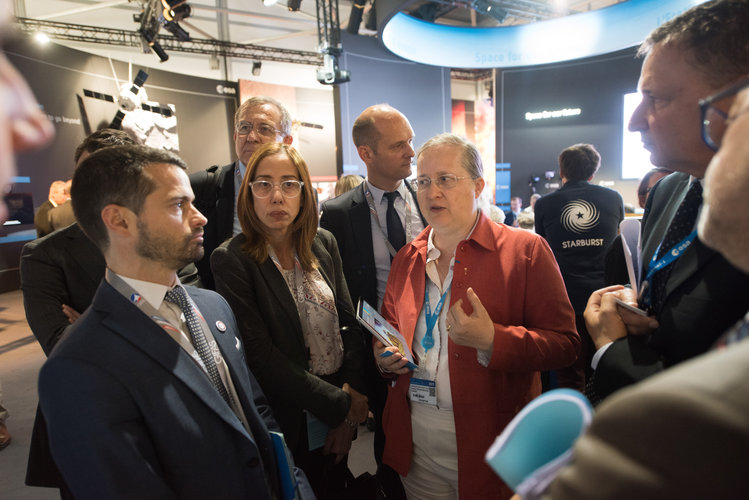 Isabelle Duvaux-Béchon shows AFD representatives the ESA Pavilion