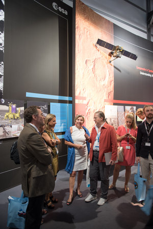 Isabelle Duvaux-Béchon shows Dominique Tilmans the ESA Pavilion