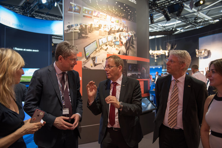 Jan Woerner shows Alessandro Busacca the ESA Pavilion