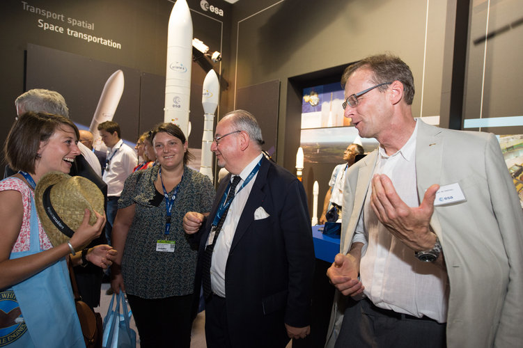 Juan De Dalmau shows the CVA members the ESA pavilion