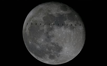 The International Space Station crosses the Moon