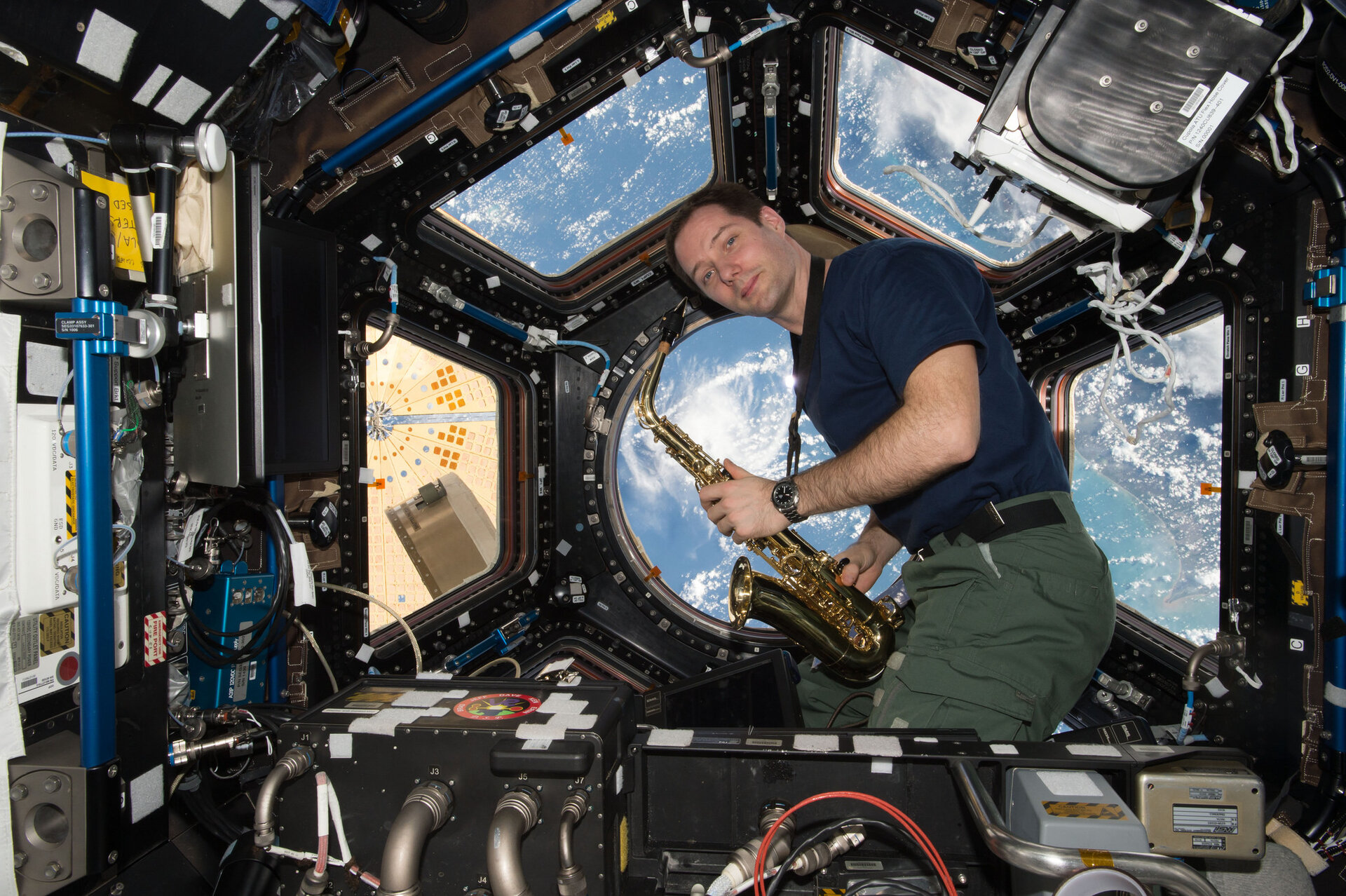Thomas Pesquet with saxophone in Cupola
