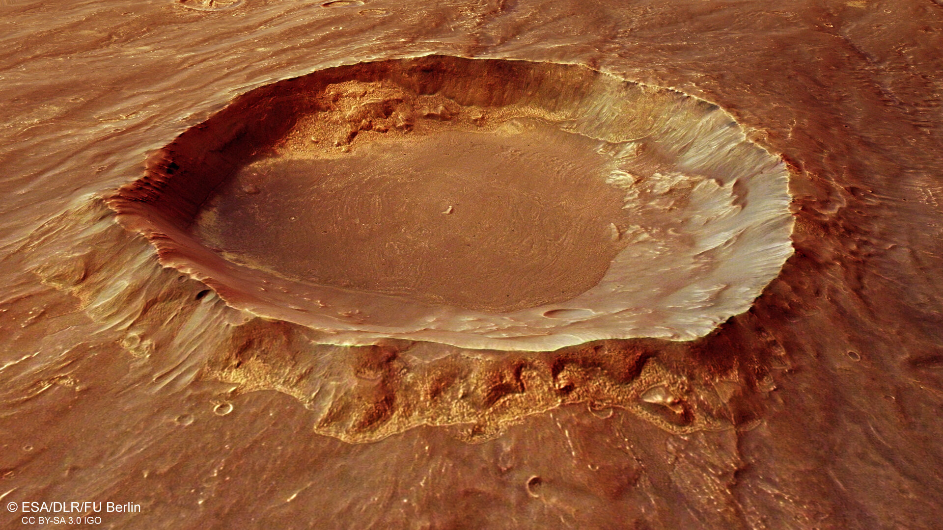 Perspective view of crater in Thaumasia mountain range