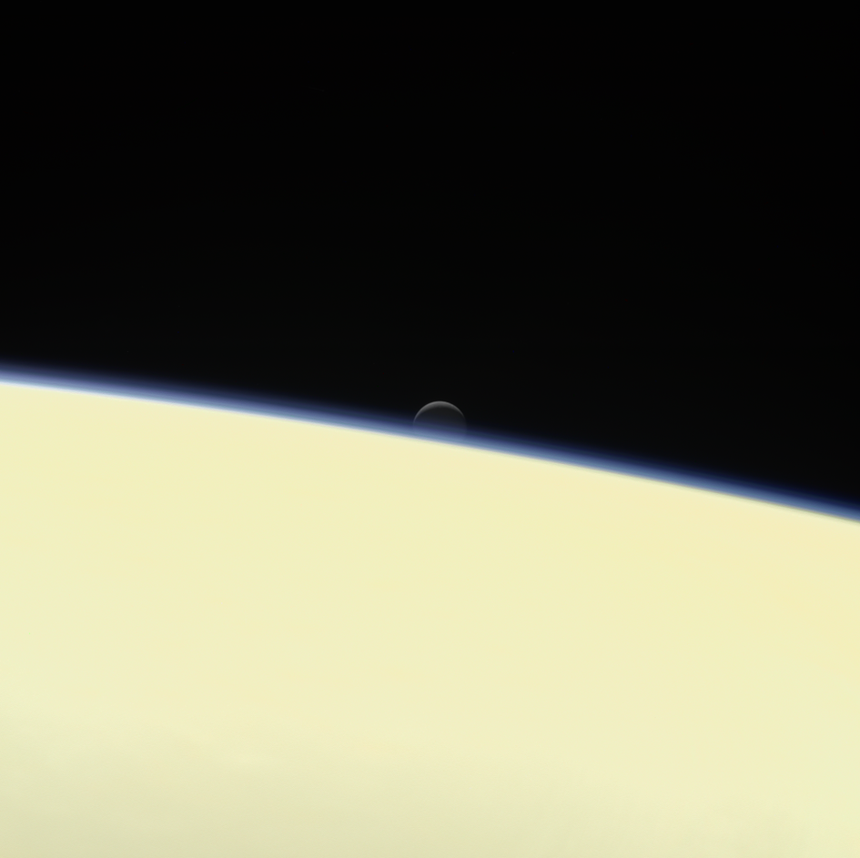 Enceladus setting behind Saturn – colour