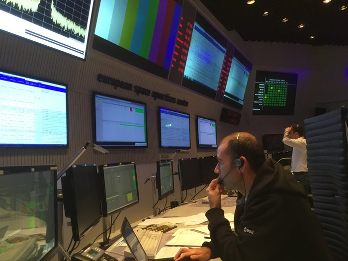 At ESOC, a member of the Sentinel-5P mission control team watches intently as data flow in from the 'satellite' – in reality, a simulation programme – during training on 7 September 2017