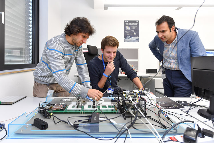Mehran Sarkarati (right) and his colleagues working at ESOC's AGSA Lab
