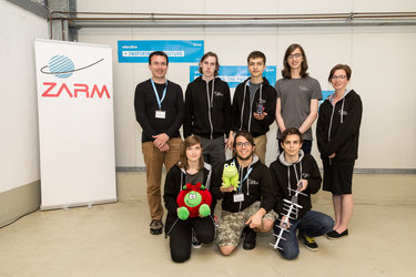 Team GWC, winners of the best report,  with their CanSat and mascot